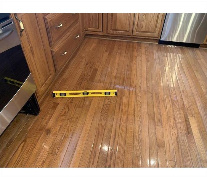 Wood flooring with a level on the boards