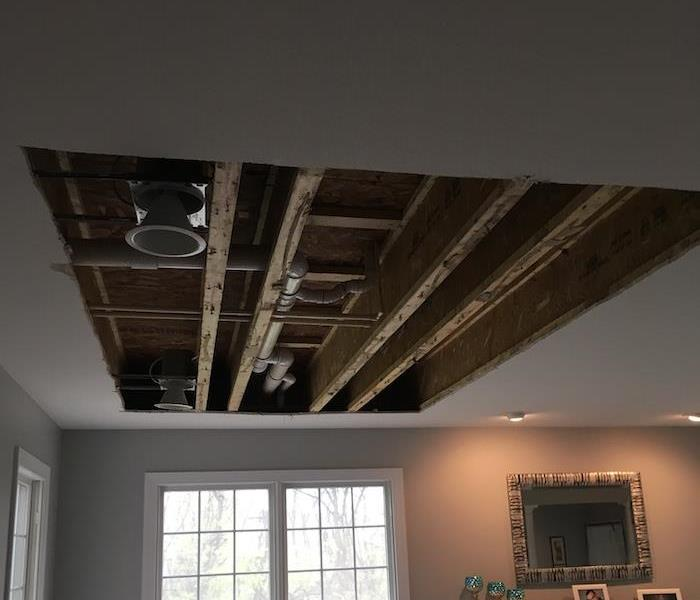 Ceiling with damaged areas cut away