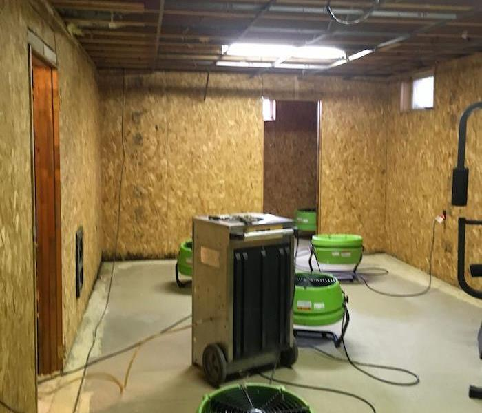 Basement with SERVPRO drying equipment and exposed framework