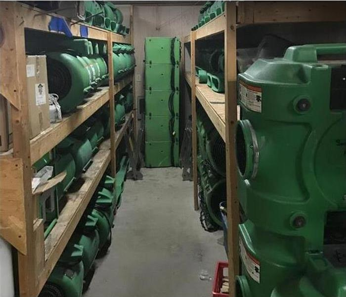SERVPRO restoration equipment stacked inside of SERVPRO storage facility