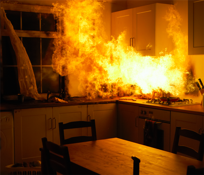 Kitchen on fire originating from the stove