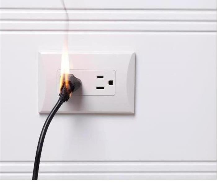 Electrical Fire at Wall Outlet in Reading Home